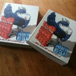 A first copy of the hard and soft covers of the book
